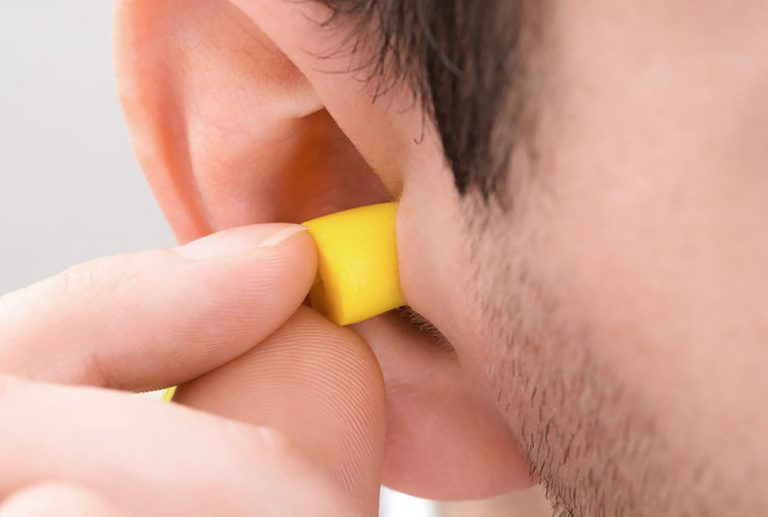 Person Ear With Earplug